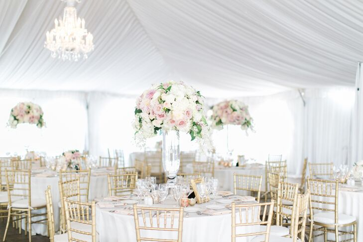 "Inside the white tent, gold accents, chandeliers and candlelight created a romantic glow. Keen on keeping the guests entertained, Bree and Greg had the tent open onto a grassy area ""all night, so our guests could socialize under the summer stars."""