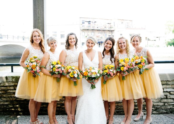 8f4d29fed3b The bridesmaids wore knee-length yellow and white dresses for the retro  homespun barn wedding