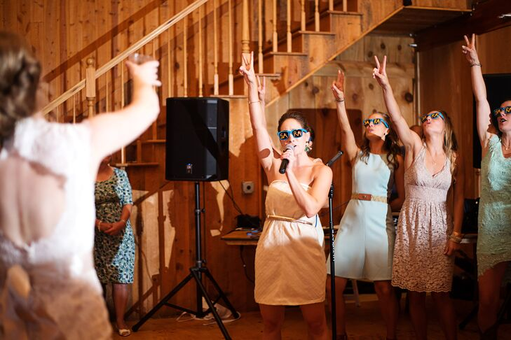 Sara's bridesmaids surprised her with a karaoke performance during the reception.