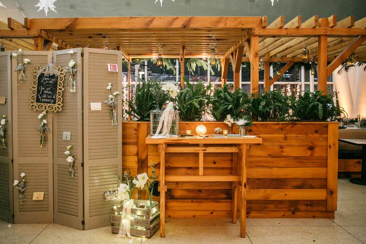 Guests were invited to write notes to the newlyweds, which were posted on vintage shutters.