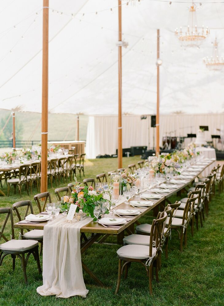 Tented Wedding Reception with Farm Tables and Elegant Table Runners