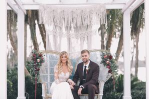 Boho Couple in Sweetheart Chairs with a Macrame Backdrop