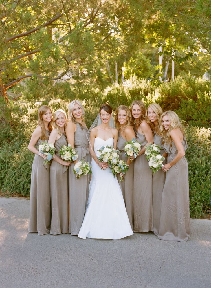 One-shoulder gowns in champagne hued silk gave the bridesmaids an air of sophistication and elegance without feeling stuffy.
