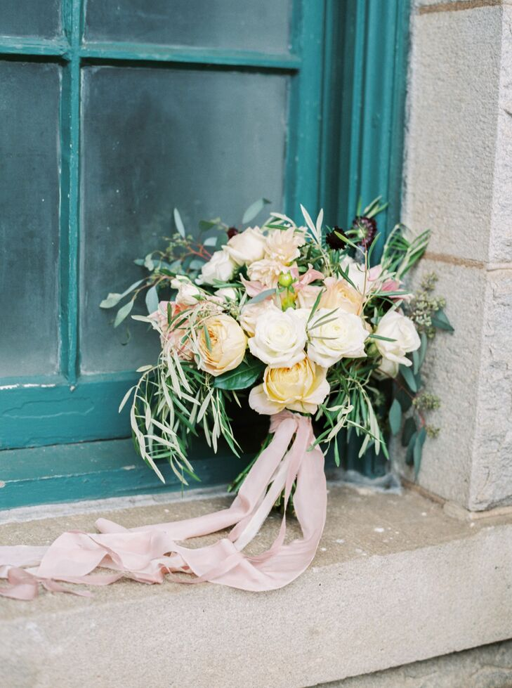 Sydney carried a bouquet of olive greenery, black scabiosa, seeded eucalyptus, cafe au lait dahlias, alabaster garden roses, caramel antike garden roses, white majolica spray roses, fresh lavender and quicksand roses.