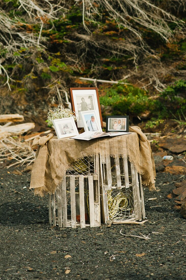 Family photos and the guest book stood atop wooden lobster traps at the beach ceremony.