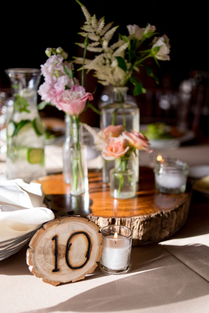 Tables were marked with circular wooden slabs that depicted numbers, so guests could find their seats. These pieces went with the other rustic elements seen throughout the day.
