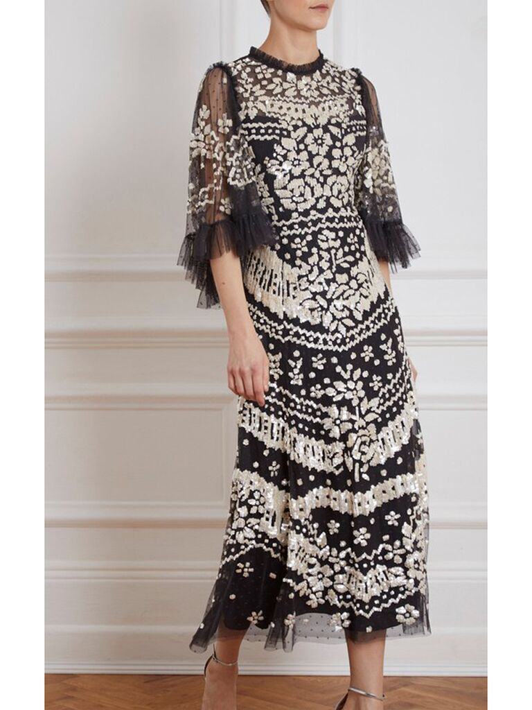 Black tulle dress with intricate embellishments and beading