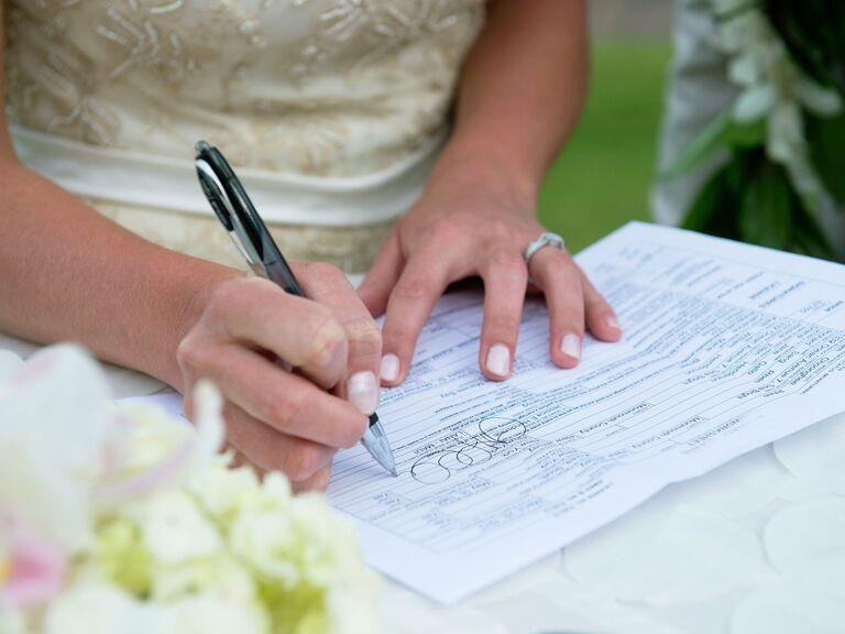 Bride signing paperwork