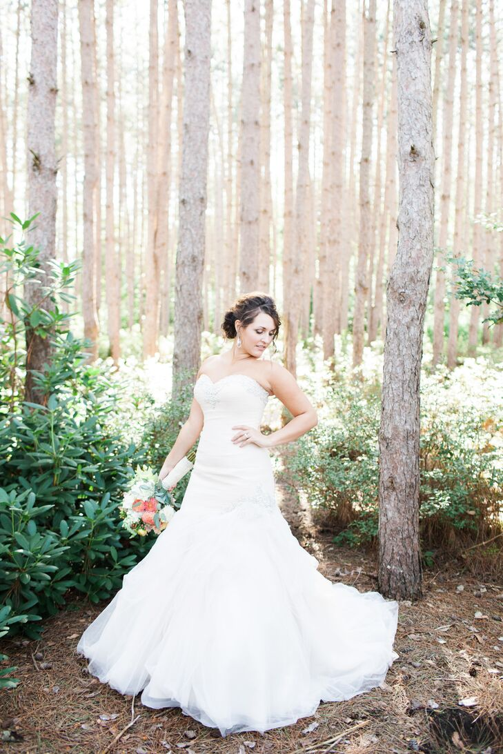 Hollie wore a strapless champagne Allure mermaid-style gown covered in soft tulle.