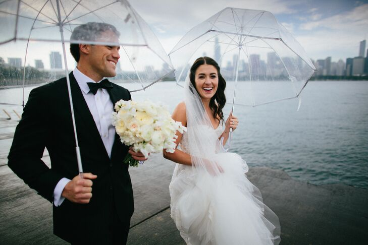 """""""I never imagined myself in something with embellishments or beading, but the dress was so beautiful on it's own and I felt amazing in it,"""" Liz says of her Monique Lhullier wedding dress. """"I knew it was the one!"""""""