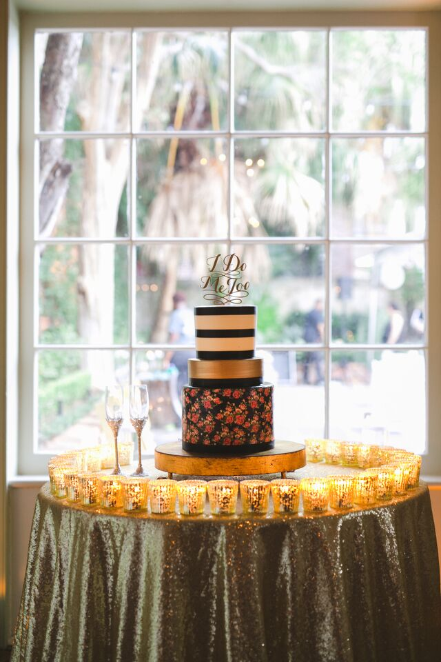 The wedding cake featured striped, gold and floral designs. Even the flavors matched the day's color palette—in chocolate, vanilla and red velvet.