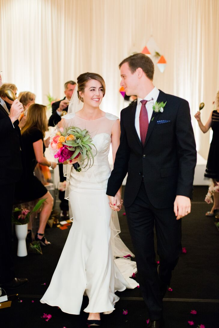 """Kelly and Adam recessed down the aisle to """"All Day and All of the Night"""" by the Kinks."""