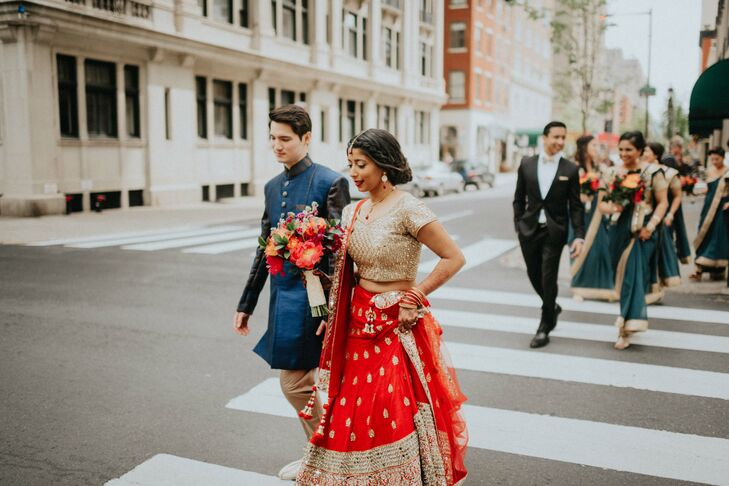 "Anjali found Christophe's blue Indo-American Sherwani during a trip to India. While a departure from traditional red, gold and white styles, the dramatic hue fit in perfectly with the couple's contemporary-meets-rustic theme. ""I also gave him a decorated sword that many Punjabi grooms typically wear, since he was obsessed with having one,"" Anjali says. ""It was a hit."""