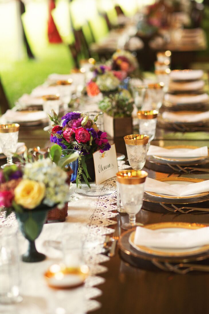 Every place setting fit Annie and Owen's whimsical style. Gold detailing circled the rim of their water goblets, charger plates and dinnerware. Bright natural tablescapes of roses, ranunculus and greenery accented each one, adding a luxe contrast.