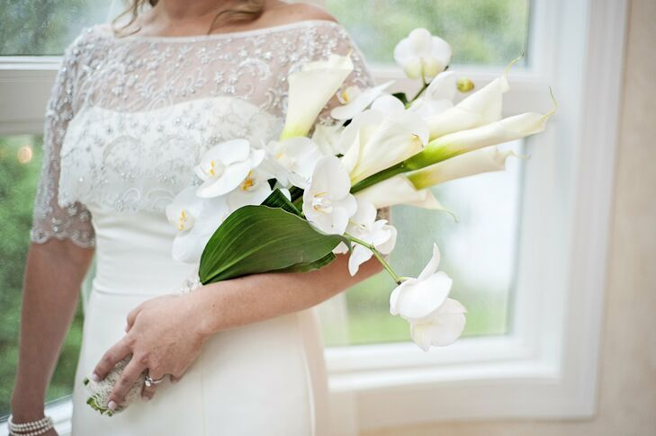 The bride carried long stem calla lilies and white orchids.