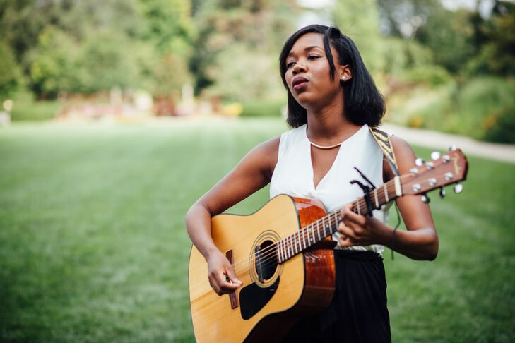 """As the wedding party and both brides came down the aisle, Lauren Elisye sang """"Latch"""" by Sam Smith, accompanied by her guitar."""