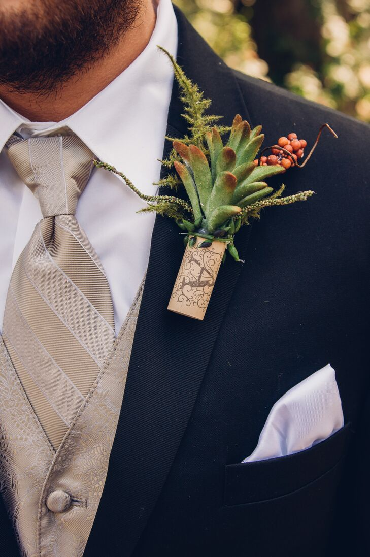 Jeff wore a succulent and berries in a wine cork for his boutonniere.