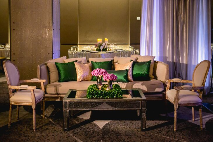 Guests lounged on luxurious furniture during the cocktail hour and reception. Amaryllis provided cream-colored couches and chairs with green pillows, and elegant tables decorated with hedge platforms and purple roses.
