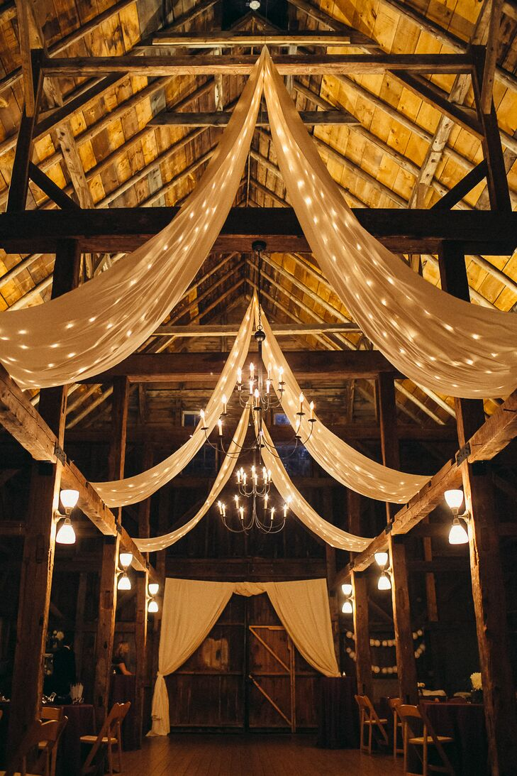 Strips of muslin hung from the roof of the barn, adding a sophisticated, elegant touch to the reception decor.