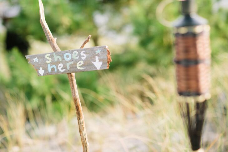 Guests removed their shoes for the sandy beach nuptials.