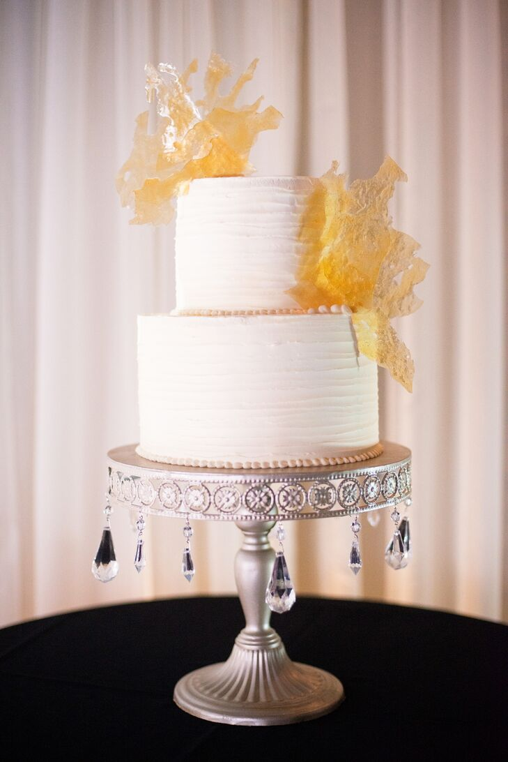 Guests were treated to a simple white and yellow buttercream cake atop of one seriously glam jeweled cake stand.