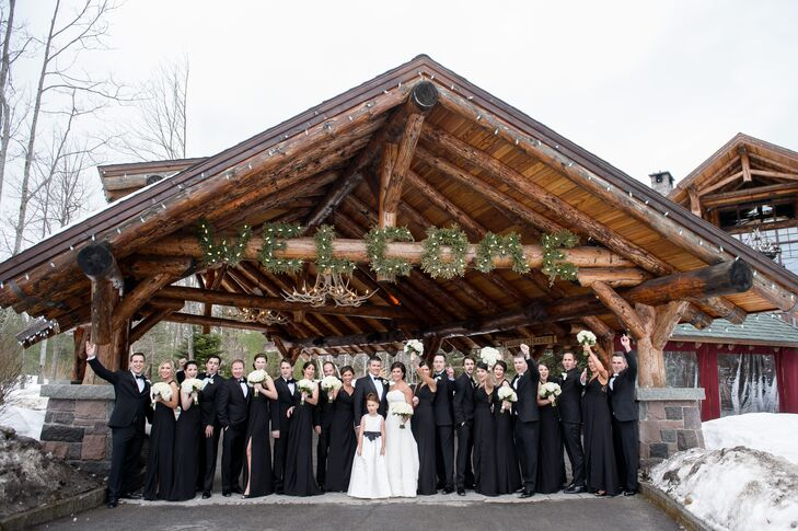 With a formal affair in mind, they went with black-tie wedding party attire. Erica's bridesmaids wore long formal gowns with V-necks from Bella Bridesmaids; the groomsmen followed Janson's lead, donning traditional tuxedos with black bow ties.