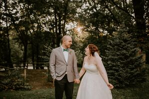 Bride in Classic Lace Gown and Groom in Grey Blazer with Green Bow Tie