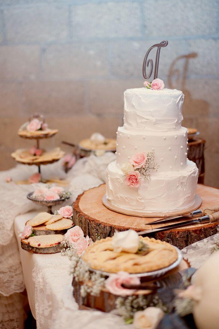 Ivory Wedding Cake On Wood Slab