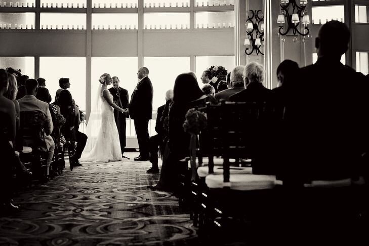 "The ceremony was held in the Boston Harbor Hotel's Warf Room, a modern space with floor-to-ceiling windows overlooking Boston Harbor. The couple kept the decor on the more minimal side, adding a few pops of color to the elegant room with bunches of fresh pink hydrangeas lining the aisle. The pair walked down the aisle to a selection of classical tunes, including ""Ave Maria,"" Kenny G's ""Wedding Song,"" and ""Canon in D,"" kicking things up a notch for the recessional with Stevie Wonder's ""Signed, Sealed, Delivered."""