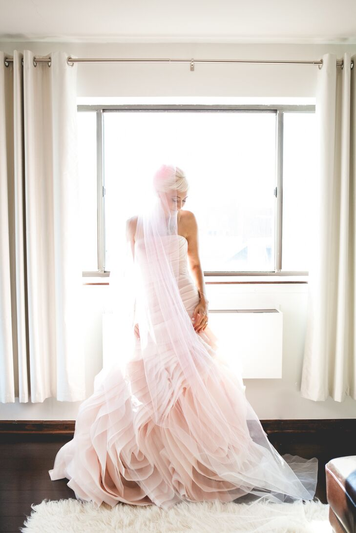 """My blush, mermaid cut Vera Wang gown was the inspiration for everything that followed finding it,"" says Jeannine. ""I've always been into clothing and design on a budget, living in thrift store jungles, so I knew that I would be looking to make my own funky, hombre veil, and dying my hair to match it."""