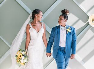 """We wanted our colors to be joyful,"" Deja Lewis and Michiah Baker recall of the inspiration for their blue-and-yellow wedding at Redondo Beach's Porto"