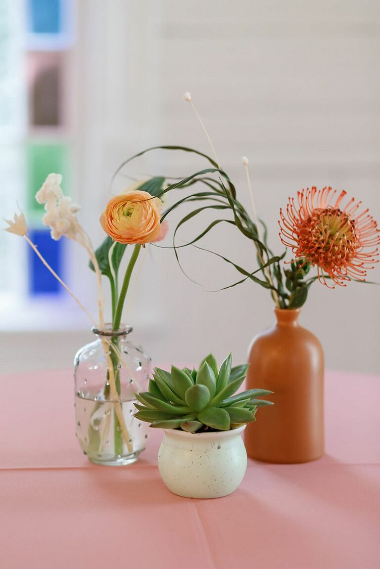 Bud vases with protea blooms, ranunculus and succulents