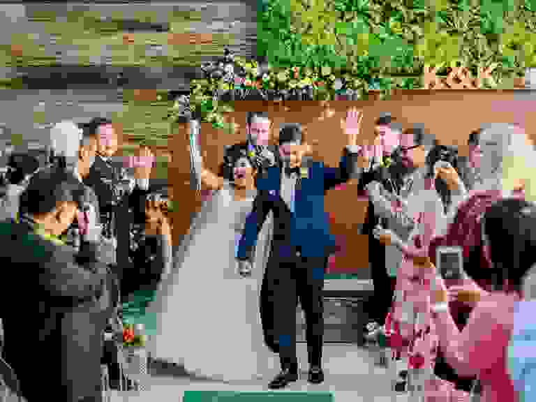 Newlywed couple at wedding with guests