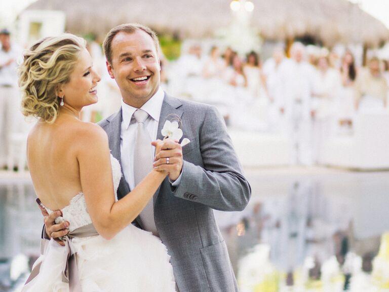 Couple dancing at beach wedding