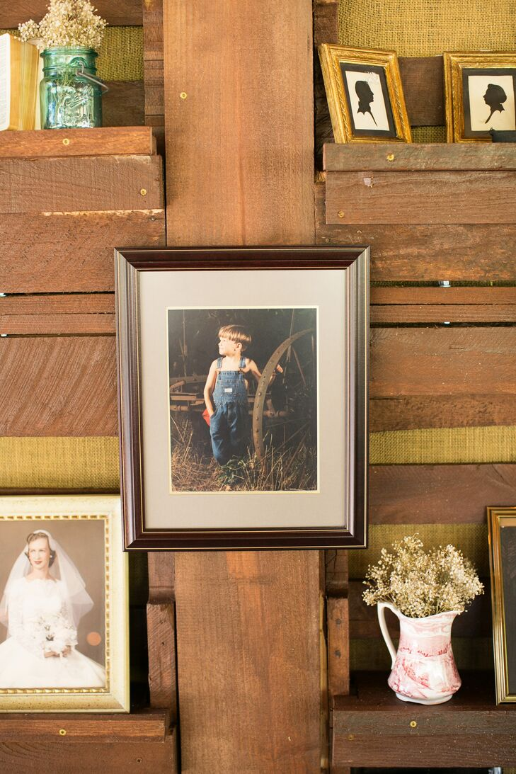 DIY wood shelves displayed antique family heirlooms as well as meaningful family photos.
