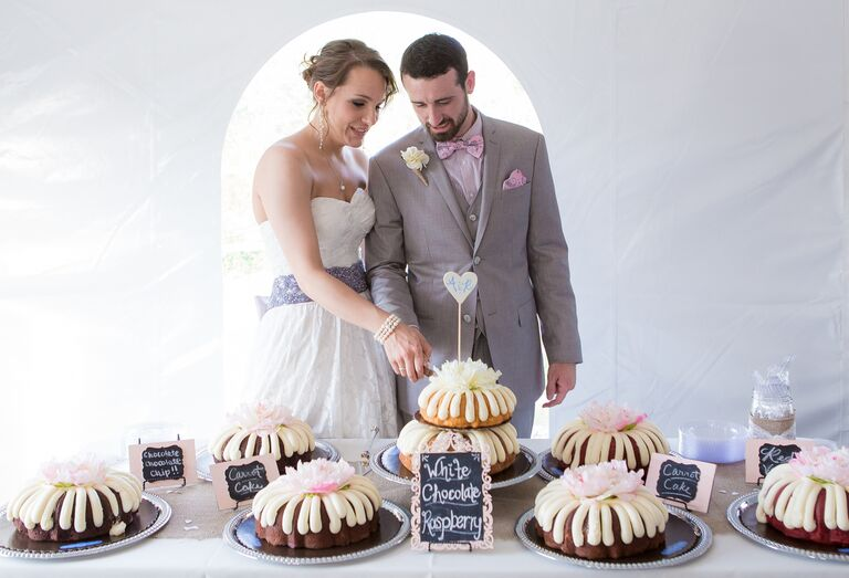 Couple cutting a two tier bundt cake