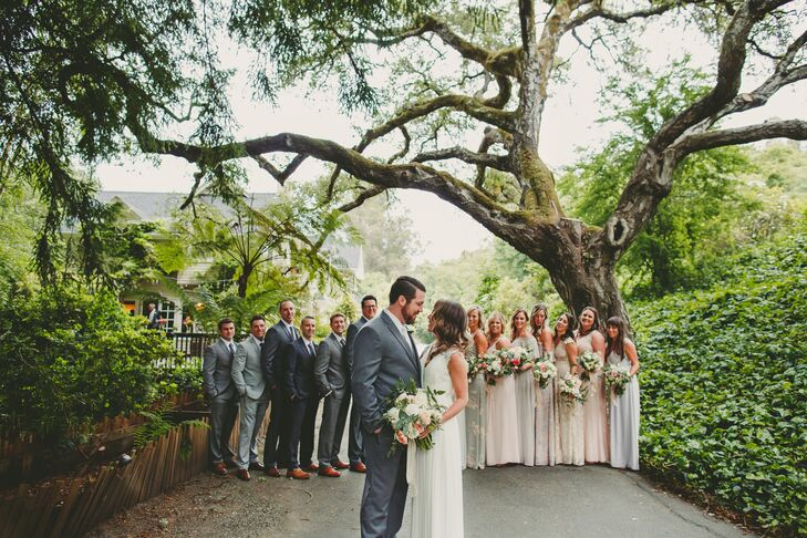 Groomsmen wore gray suits of their choosing, while bridesmaids selected full-length gowns in varying shades of blush, gray or ivory. Instead of a veil, Crystal wore a Jennifer Behr comb that tied in with the relaxed setting at Sand Rock Farm Bed and Breakfast in Aptos, California.