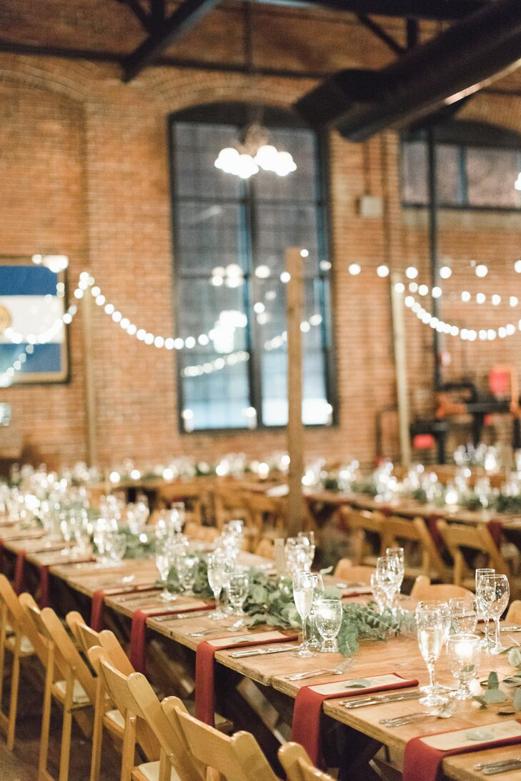 """We actually booked the venue sight unseen, since we live in Chicago,"" Desta says, ""but I had this really good feeling about it. I'd always wanted a barn wedding—probably because I grew up in Kentucky—but I loved the vibe of the museum so much. The exposed brick and pipes, as well as the exhibits, gave the space so much character."""