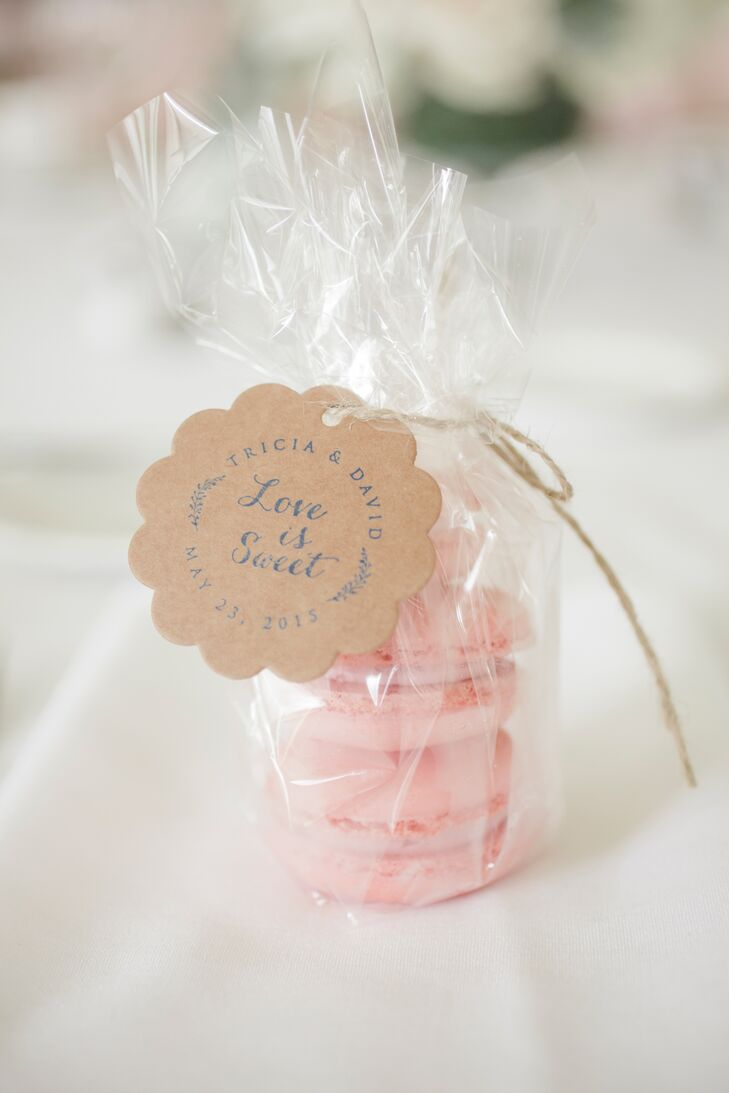 In keeping with the pale pink color scheme, guests took home little bags of raspberry macarons.