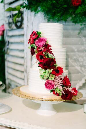 Buttercream Wedding Cake With Rich Pink Floral Cascade