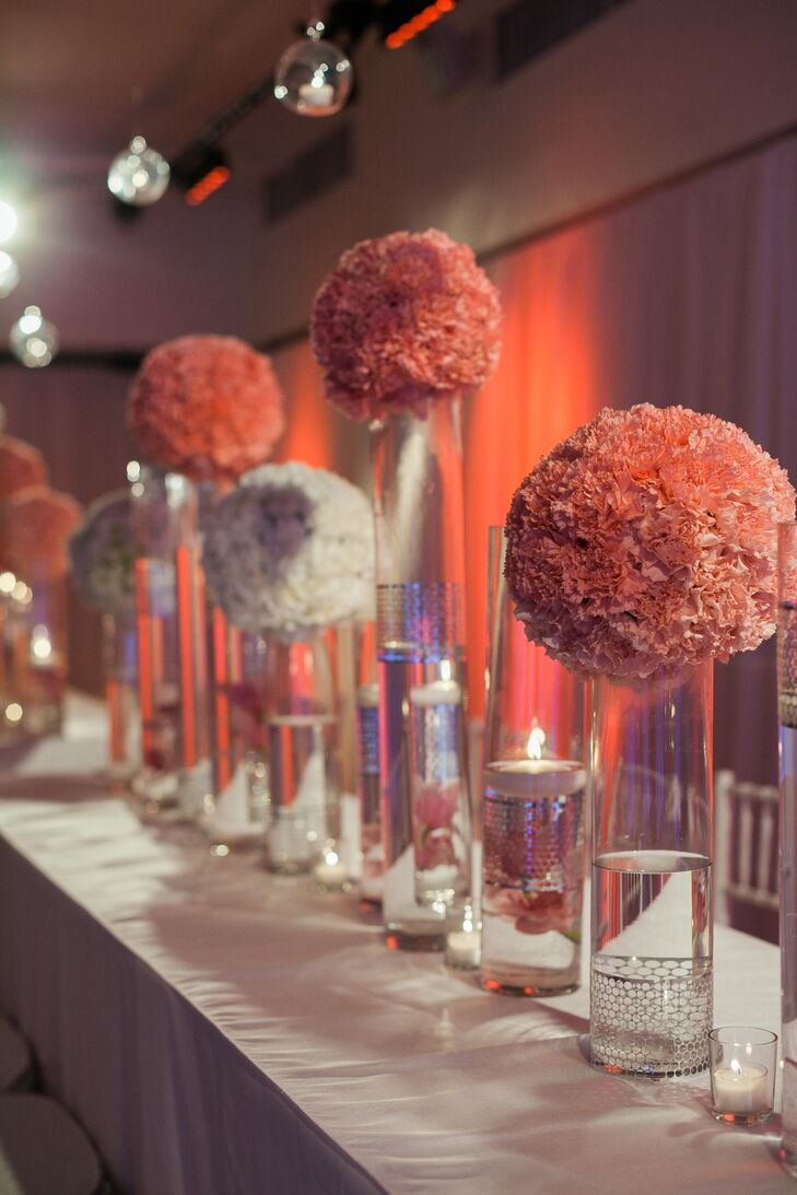 Lush pink and white hydrangea centerpieces were places in tall glass cylinders for a modern yet romantic look.