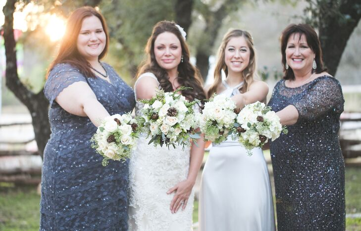 The bridesmaids wore dresses in gold, silver and champagne tones.