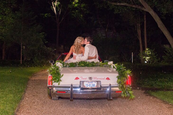 Couple Exiting in Classic Cadillac Convertible
