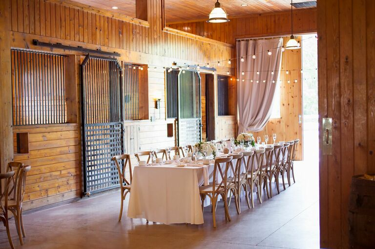 Wedding reception in rustic horse stable