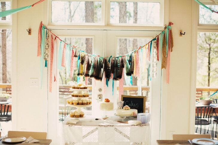 A colorful ribbon garland was draped over the dessert table.
