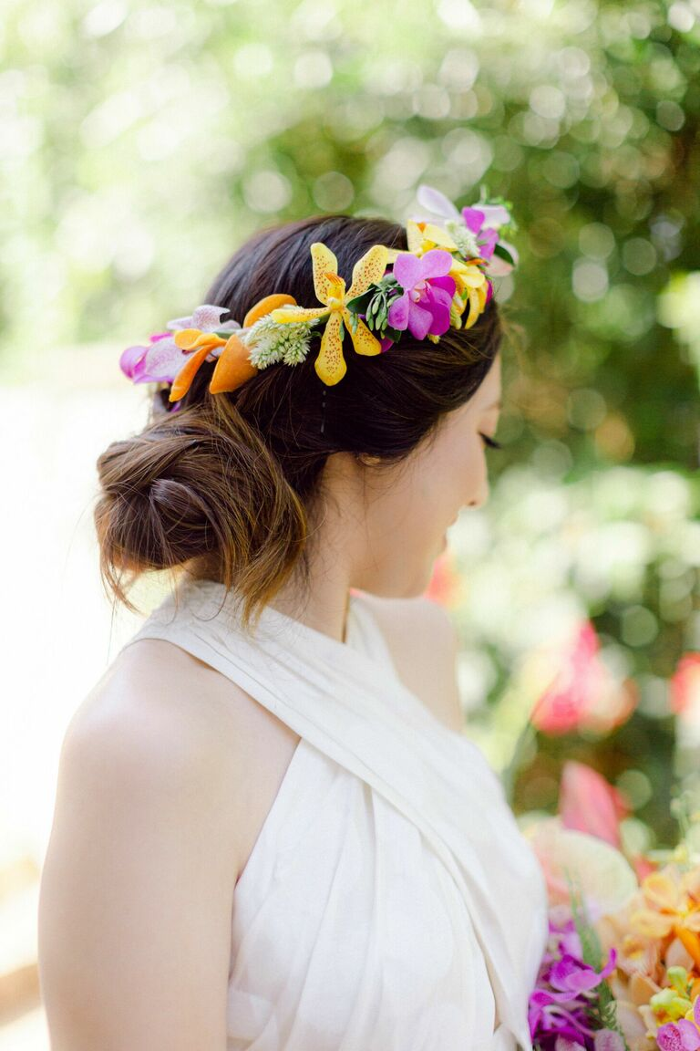 Bride wearing flower crown with orchids