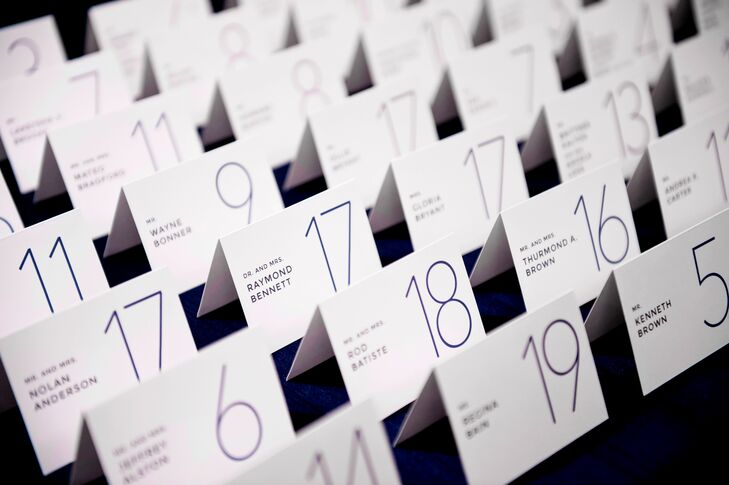 Escort cards were embellished with a sleek and contemporary purple font.