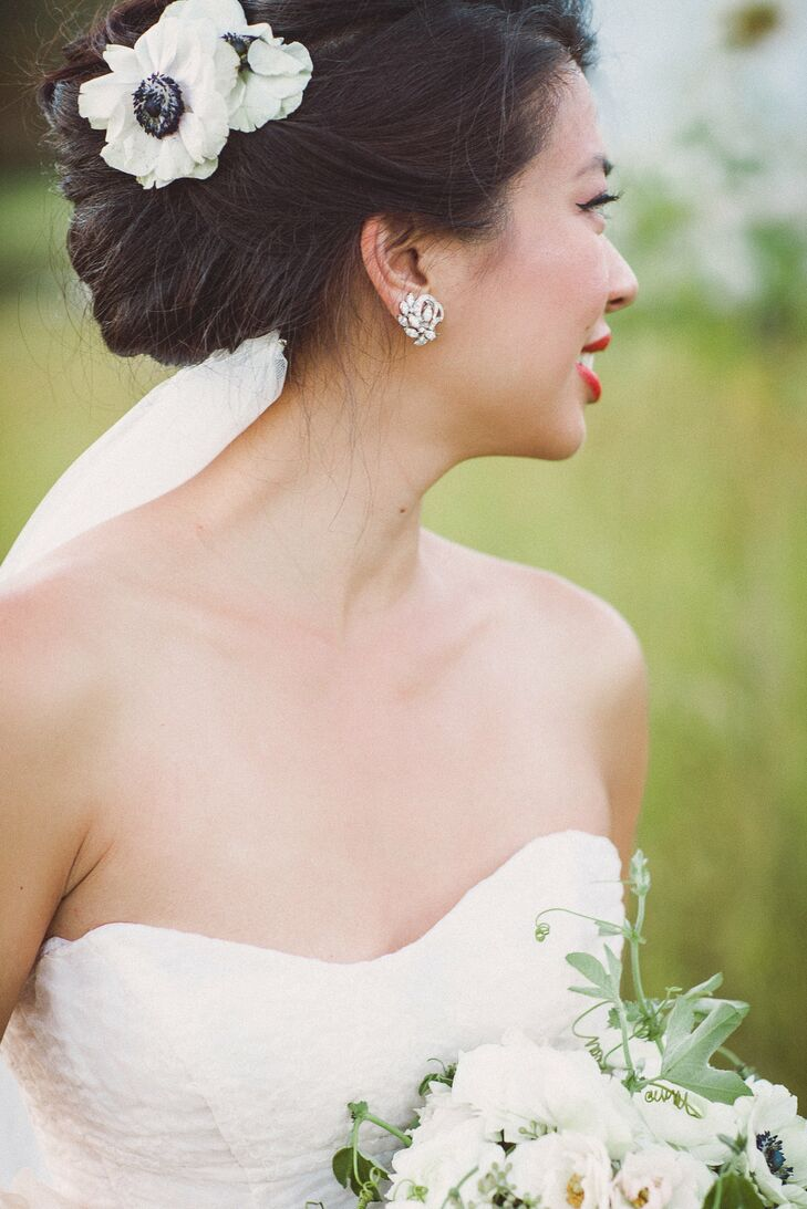 Olivia's elegant updo was accessorized with fresh white anemones.
