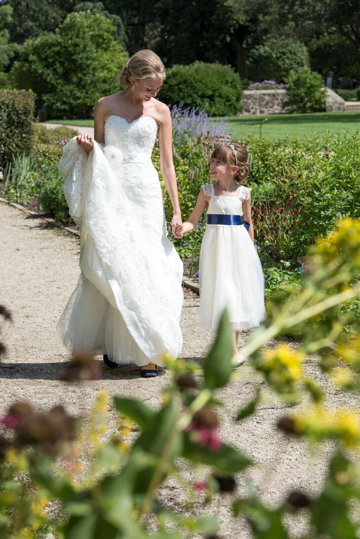 The flower girl wore a traditional white dress with a navy sash to match the bridesmaids.