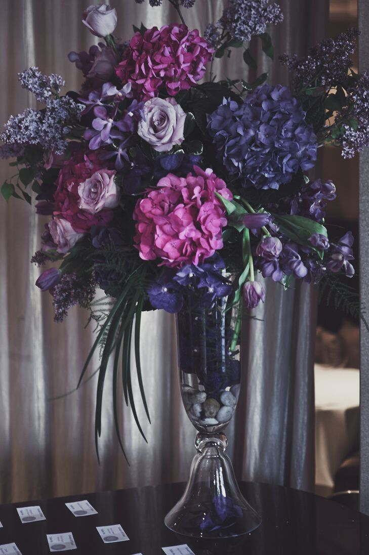 The elegant flower arrangements had purple roses, hydrangeas and tulips.